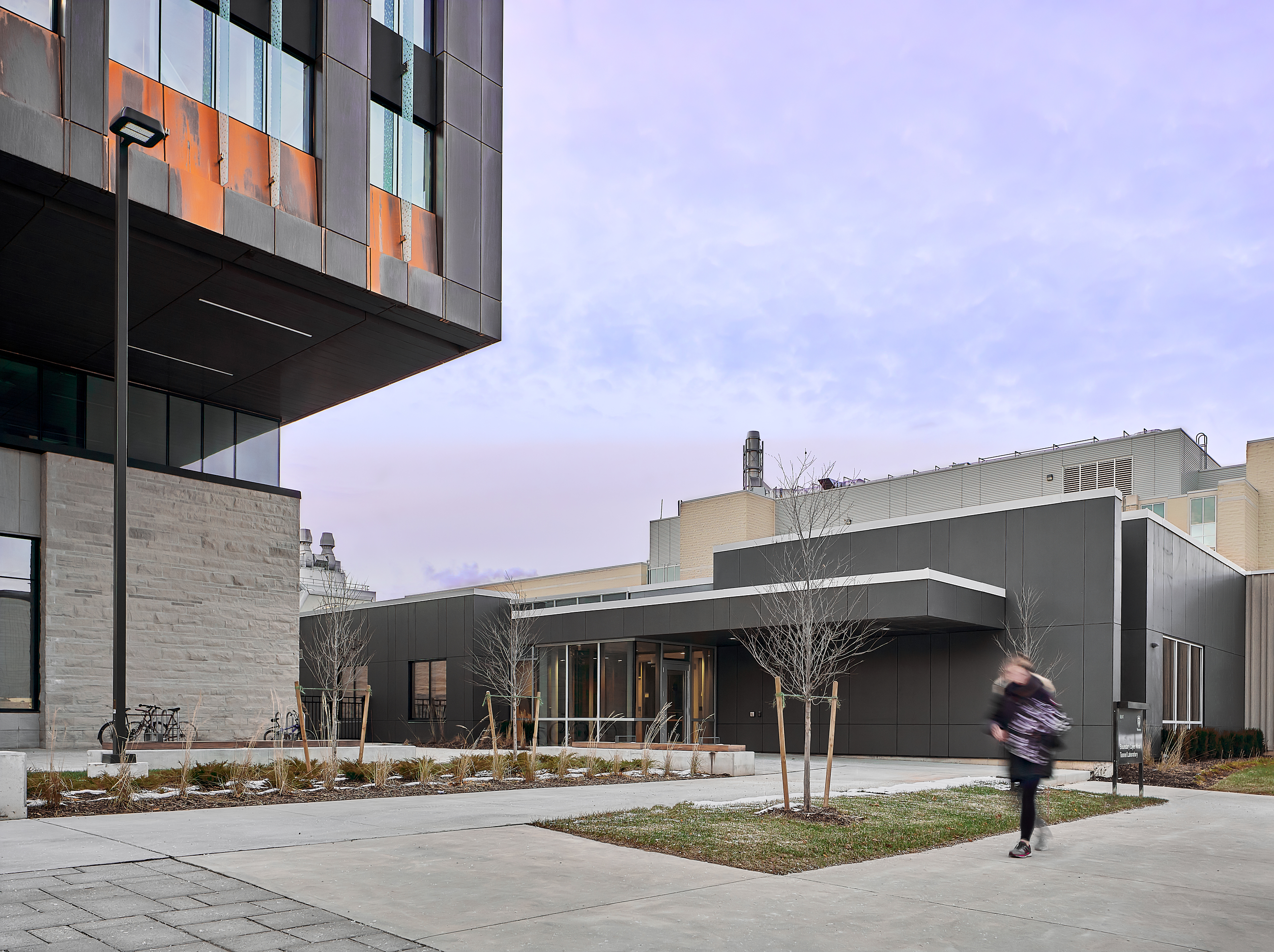 Photo of the renovated Boundary Layer Wind Tunnel Building and portion of the Amit Chakma Engineering building during awkward phase.