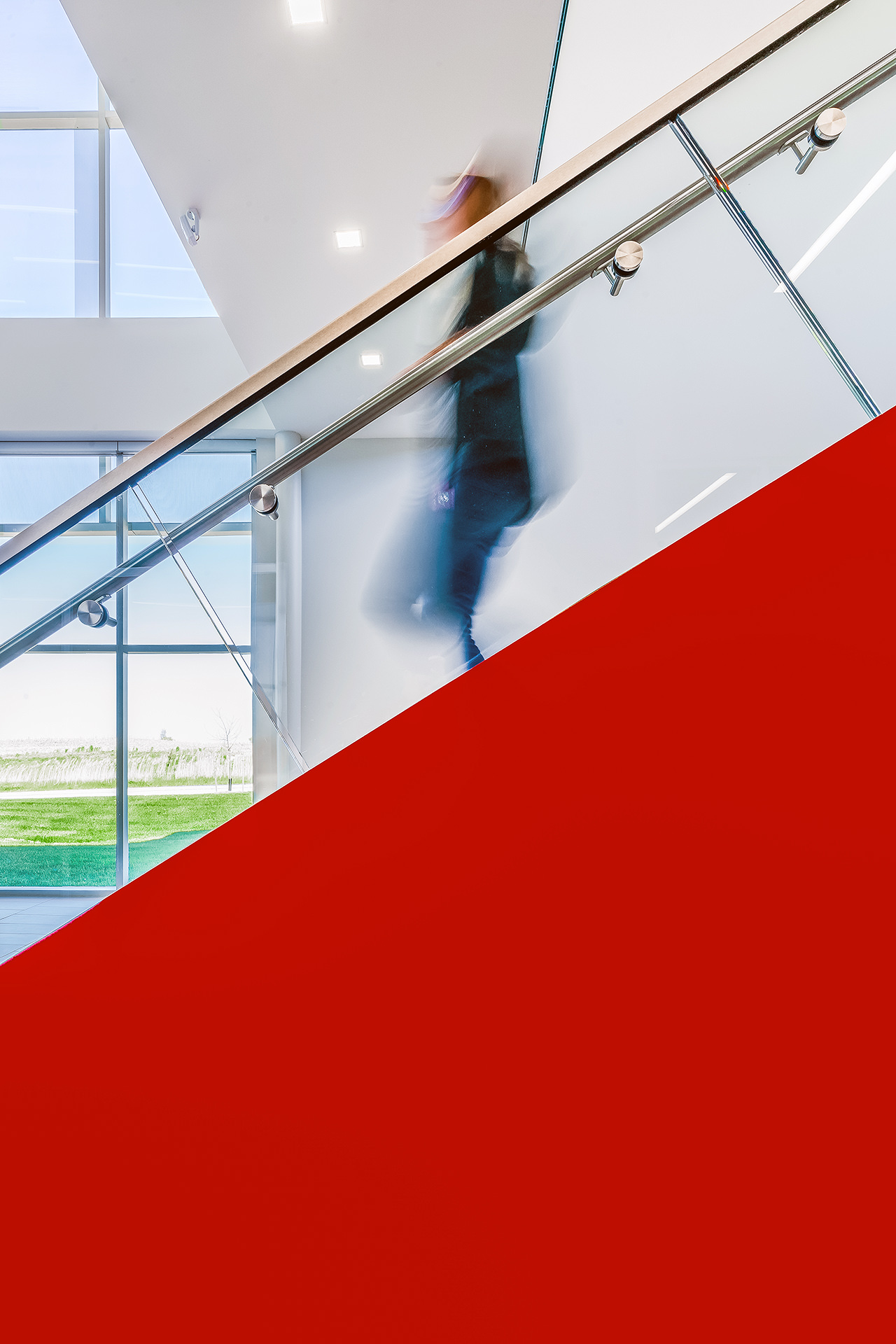 Interior photograph of girl walking down stairs inside Canadian Centre for Product Validation